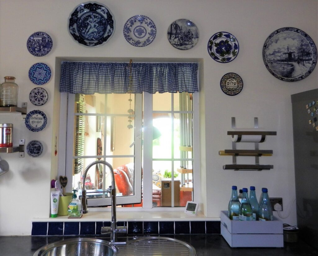Organise your wall decor, blue tiles against the wall.